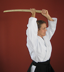 Woman with bokken raised